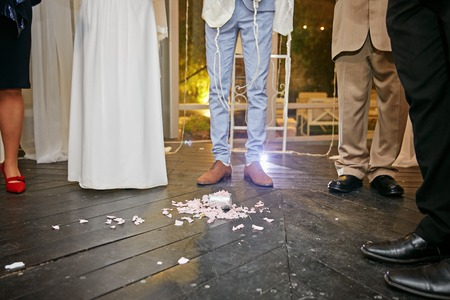 Groom breaking a glass at a Jewish wedding