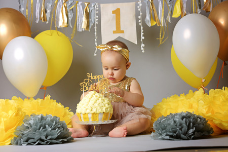 Little girl celebrate Happy Birthday Party, Portrait of eating baby girl with dirty face in high chair