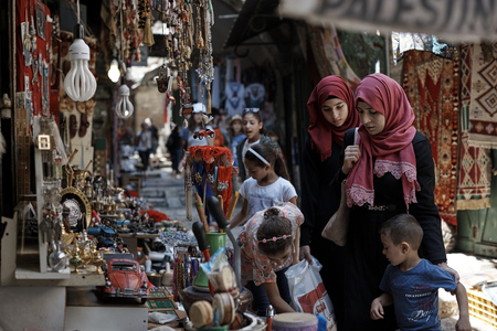 JERUSALEM - CIRCA august 2018: Muslim Women and a Jewish man go about daily life in the Jewish Quarter of the Old City of Jerusalem in Israel. The rich cultures regularly interact on a daily basis.