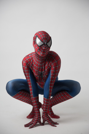 Central, Hong Kong - 19 August 2018: A man cosplaying the famous Marvel comic character - Spiderman and posing to take pictures