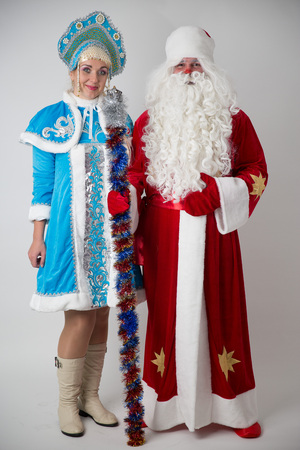 Santa Claus and Snow Maiden on a white background. December 31. 2017