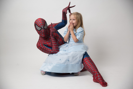 Israel, Tel Aviv October 14, 2018. The spiderman is holding a little girl in his arms. A man in a spiderman suit came to congratulate the child on his birthday. Spiderman Costume Rental
