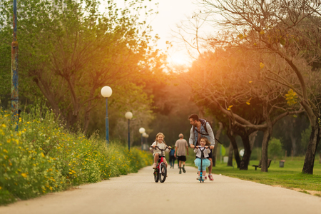 Father and daughters spending time together in park