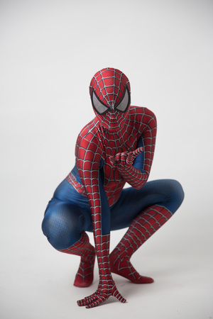 Central, Hong Kong - may 19, 201: Man in superhero costume comic marvel spider on gray background