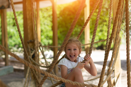girl on the obstacle course, high ropes course, summer, joy, health, good morning Standard-Bild - 123141487