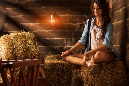 beautiful woman in style of the country on hay