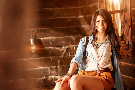 Charming woman with beautiful smile in a barn Stok Fotoğraf