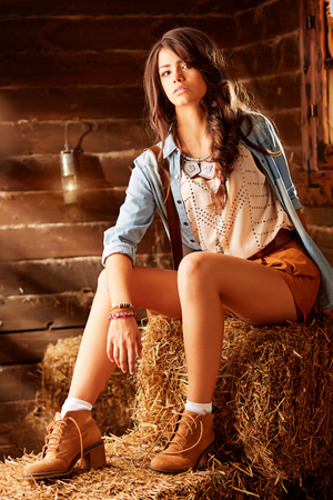 Beautiful young woman in leather shoes, rural life