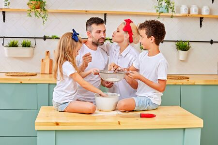 Happy family cooking in stylish kitchen together