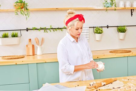 Woman with rolling pin in the kitchen