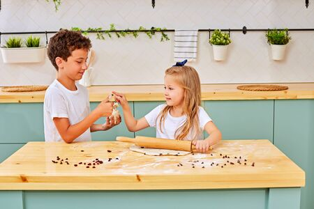 boy and girl play with dough. Happy loving family