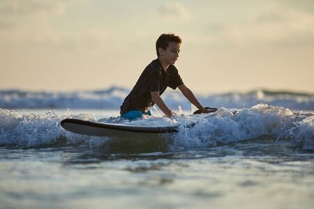 Surfer taking surfboard and comming with long surf board to waves
