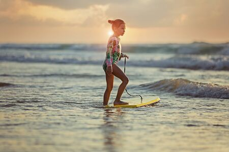 young surfer ride on surfboard with fun on sea waves.