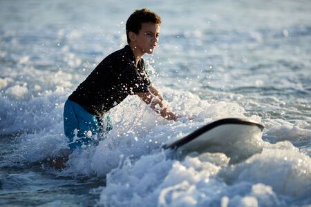 surfer battles the waves on a beautiful sunny day