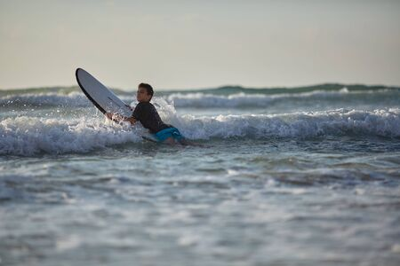 guy conquers the waves on the surfboard