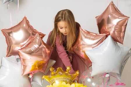 girl playing with balloons in the studio