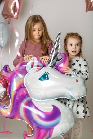 fun birthday with pretty little girl. Festive party with a unicorn Stockfoto