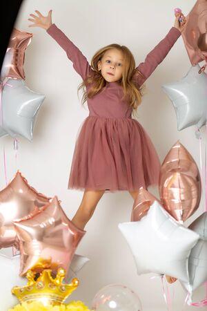 Joyful Girl with balloons on white background