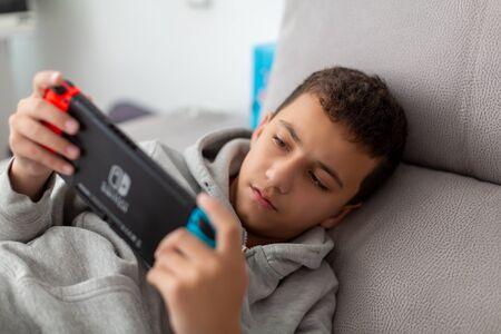 tel Aviv, Israel - January 01, 2020: A man playing Nintendo Switch