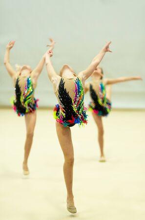 gymnastics three gymnasts perform sport exercises on the show