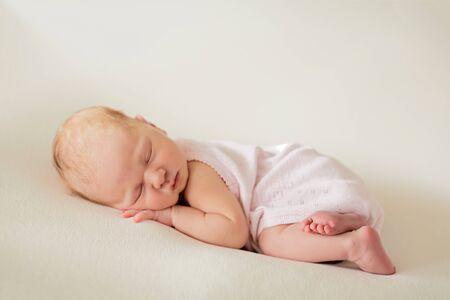 Sleeping newborn baby girl on a blanket. Baby goods packaging template Stock fotó