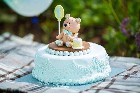 Amazing cake for boys first Birthday. Blue and white colors with Bear cub from sugar mastic