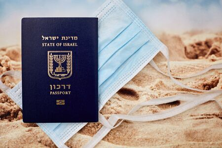Coronavirus and travel concept. Note COVID-19 coronavirus, passport and mask. Coronavirus outbreak, epidemic in Israel. Travel restrictions and quarantine of tourists infected with Coronavirus. Reklamní fotografie