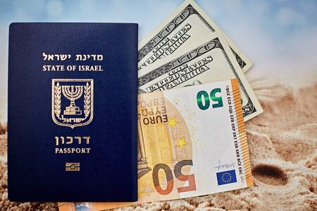 international passport of Israel with 50 euro and 100 dollars banknotes