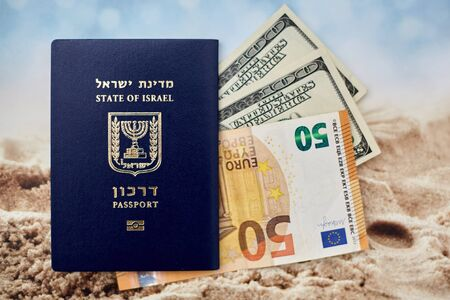 international passport of Israel with 50 euro and 100 dollars banknotes.