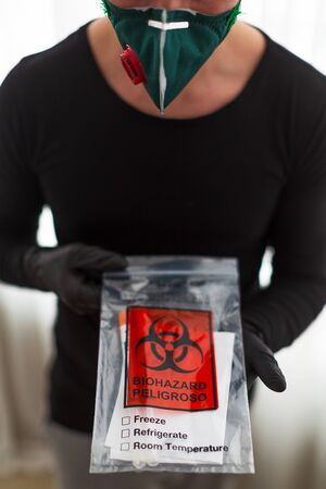 man in a protective mask holds a test Reklamní fotografie