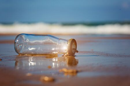 Reduce waste in the sea, Ecological and environmental problems. glass bottle on the beach.Trash on the beach