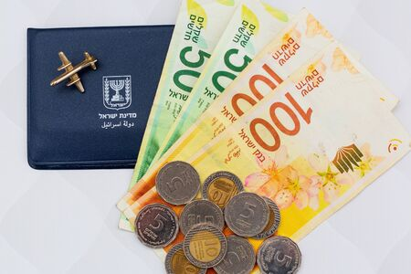 ID and shekels, coins. politics money and financial crisis of rich Israel background. saving cash. business in Israel.