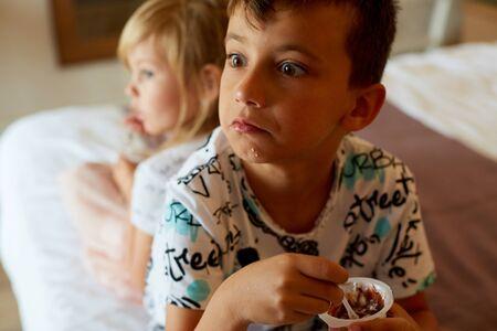 surprise boy eats chocolate yogurt 写真素材