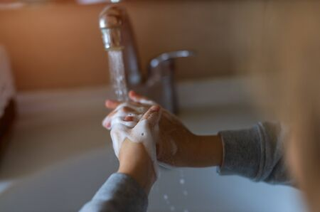 girl washes his hands correctly. How to wash your hands correctly. Hand washing . Coronavirus 写真素材