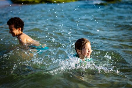 funny children playing in the water
