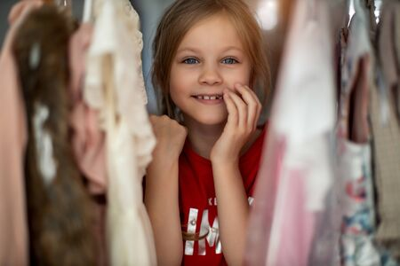 Pretty girl choosing clothes 写真素材