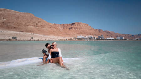 Aerial image of Couple on a dead sea beach at Israel