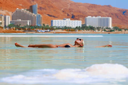 sexy girl swims in water of Dead Sea in Israel