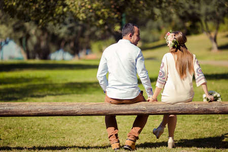 couple is hugging and sitting close in the park Stok Fotoğraf