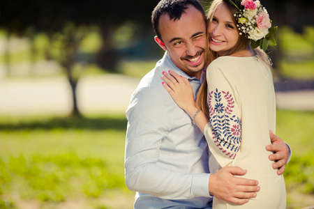 couple in love hugging and smiling in the park Stok Fotoğraf