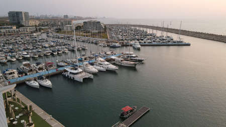 group of boats are moored together at a small marina in the Herzliya Marina Stok Fotoğraf