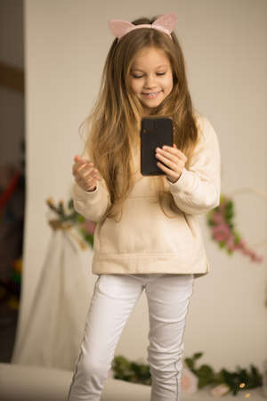 Close up picture of cute lovely beautiful girl speaking in front of camera for vlog. Teenager working as blogger, recording video tutorial for Internet