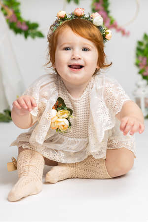 portrait of redhead, beautiful smiling infant baby girl, one year old