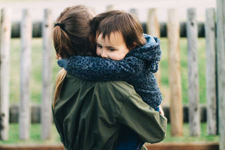 mother and daughter hugging in love playing in the park Reklamní fotografie