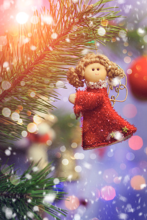 angel tree: Red angel doll. Christmas tree decoration. in sunlight.