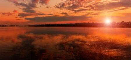 Morning city lake landscape with sunrise. dramatic scene. beauti of the world