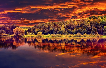 fantastic view of the dark overcast sky , reflected in the water in river Dramatic and picturesque evening scene. majestic, unusual sunset. Beauty world.