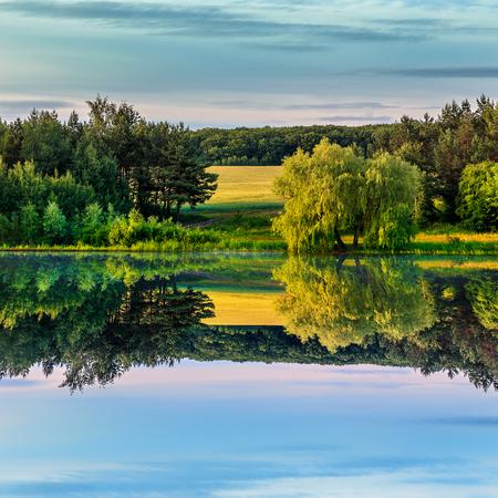 wonderful autumn landscape. colorful trees over the river. Nature landscape