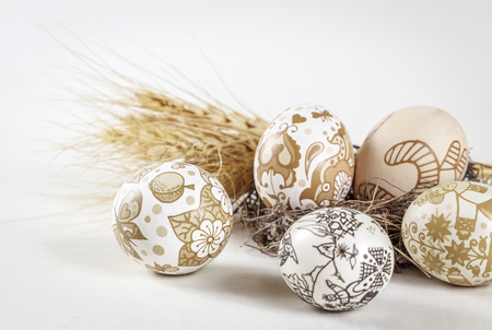Easter background. Handmade Easter eggs, ears of wheat, on a white background. Easter theme. Happy Easter