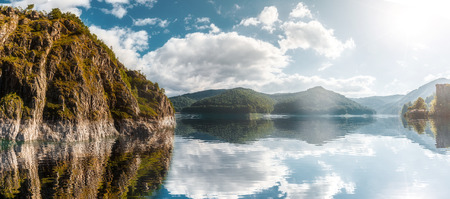 wonderful sunny landscape. mountain lake with perfect sky reflected in water. of Vidraru Lake and Dam. creative image. location. Vidraru Dam, Romania. Carpathian Mountains, Fagaras ridge.